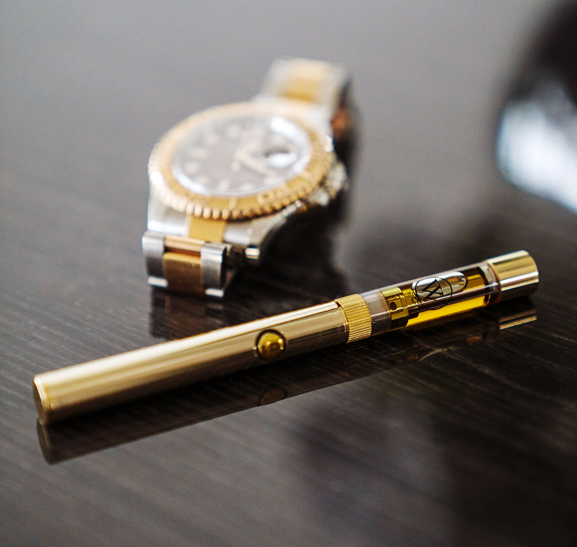Westcoast Smoke Gold Digger Next To Gold Watch